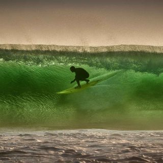 Surfer Luke Underwood at Crab Island County Clare by George Karbus