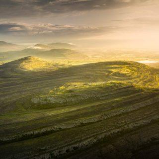 Spectacular sunrise above Mullaghmore mountain in Burren.